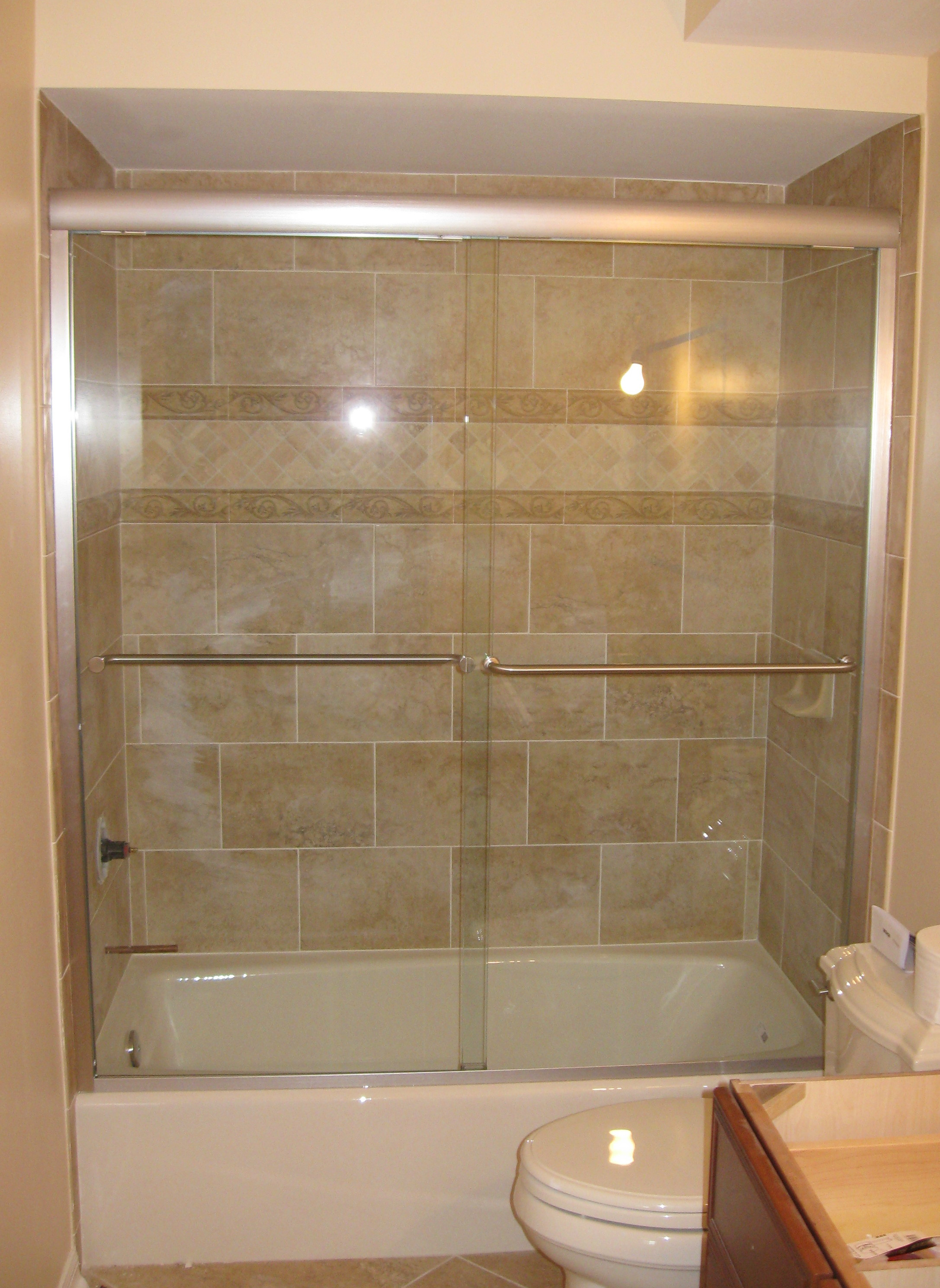 Bathroom shower doors frameless - Deluxe Alumax Tub Slider Brushed Nickel Hardware Clear Glass Semi Frameless Door